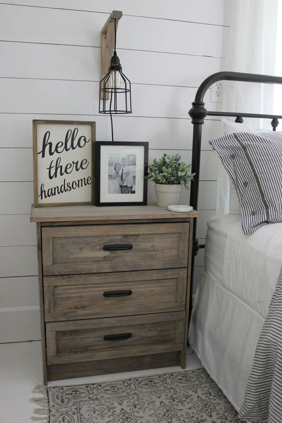 a light-colored plywood Rast nightstand with black handles for a vintage farmhouse space