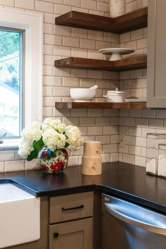 thick wooden corner shelves in a farmhouse kitchen add texture and interest to the space