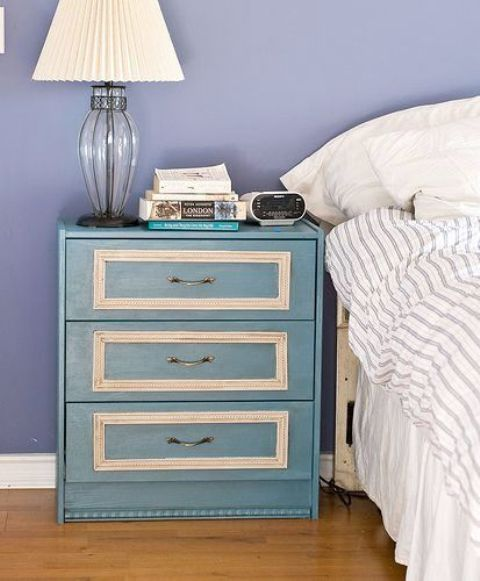 a teal IKEA Rast with vintage molding and farming plus handles for a refined look