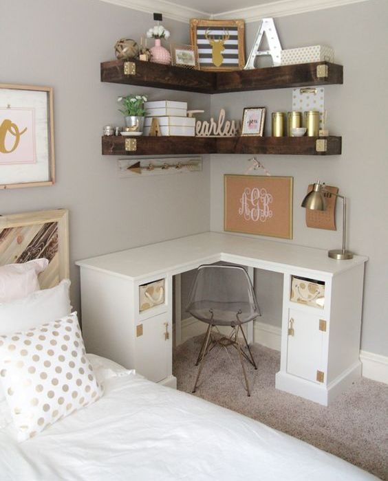 thick wooden corner shelves over a desk help to save much space in the room