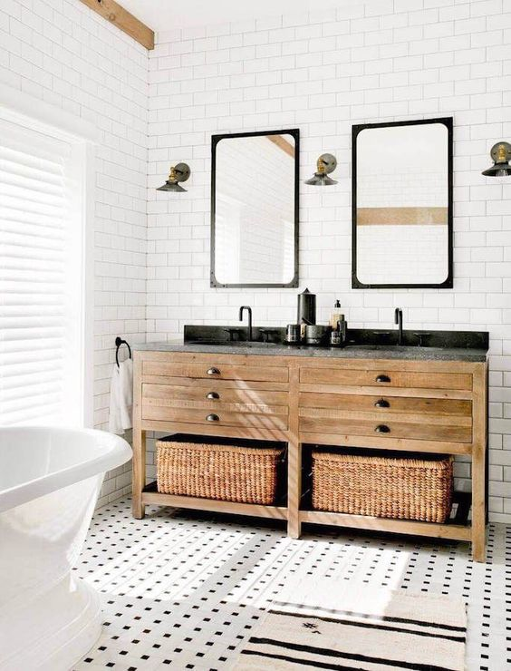 cool mosaic tiles on the floor and a double wooden vanity with baskets for storage