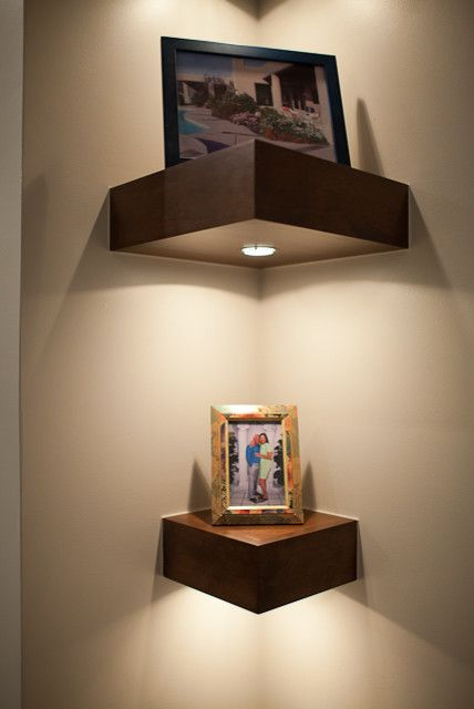 very thick corner shelves with additional built-in lights are ideal for an entryway