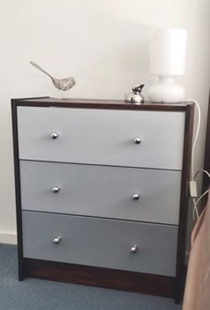 IKEA Rast nightstand hacked in dark stain and with ombre grey drawers and silver knobs is a trendy idea