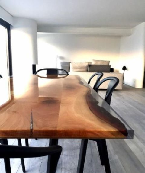a resin and wooden live edge wood dining table is a gorgeous way to make a statement in a modern space