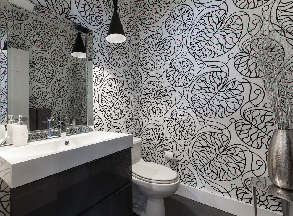 printed black and white wallpaper is a chic and trendy idea for a bathroom or a powder room
