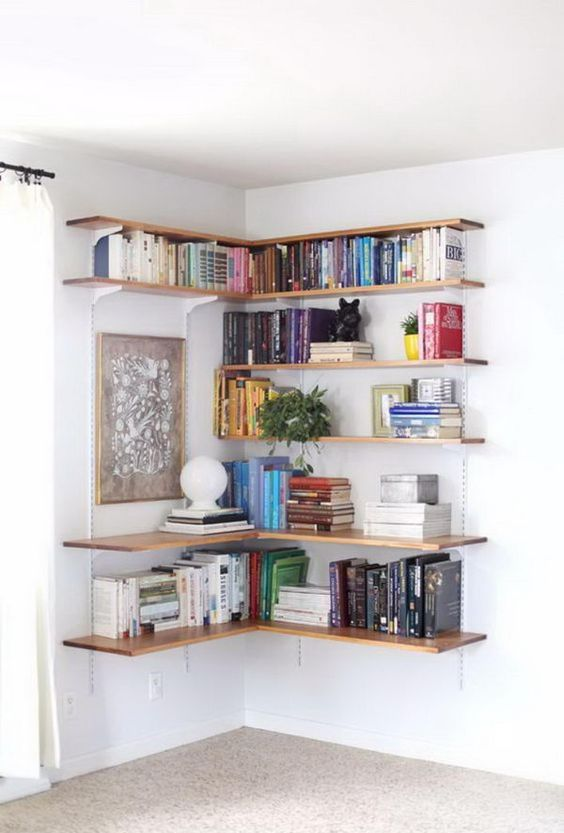 a whole corner shelving unit for books is ideal for storing anything you want and decorate an awkward corner