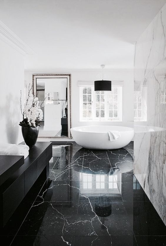 a black marble floor is a timeless solution that never goes out of style and looks wow