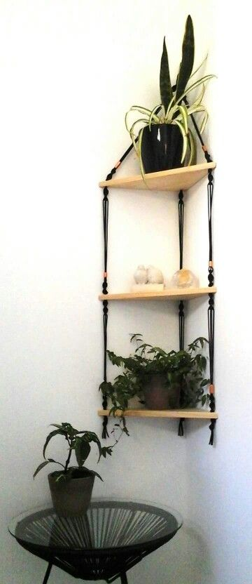 a triangle shelving unit in boho style of wood, macrame and beads looks very cool and cute
