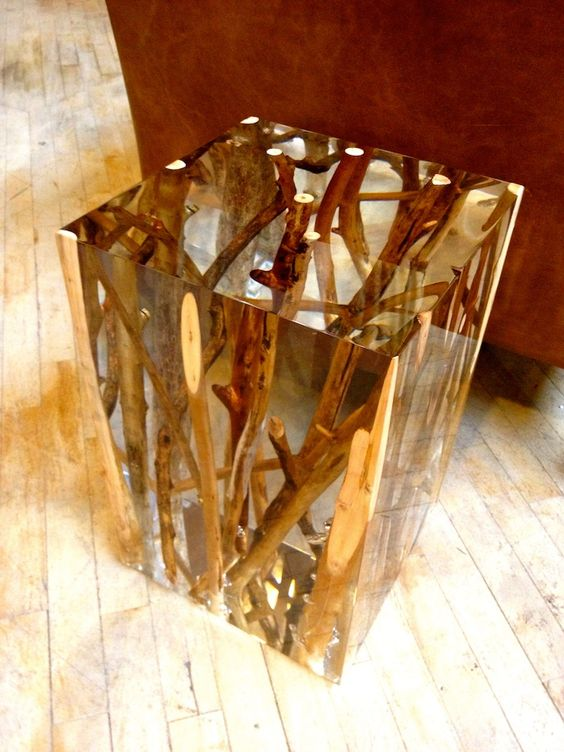 a gorgeous side table of resin with branches inside looks both natural and modern at the same time
