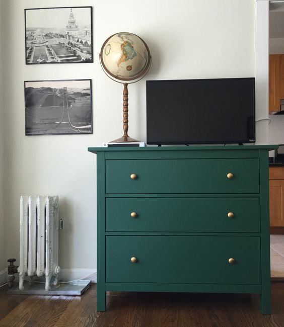 an elegant emerald green Rast dresser with gold knobs is a chic idea