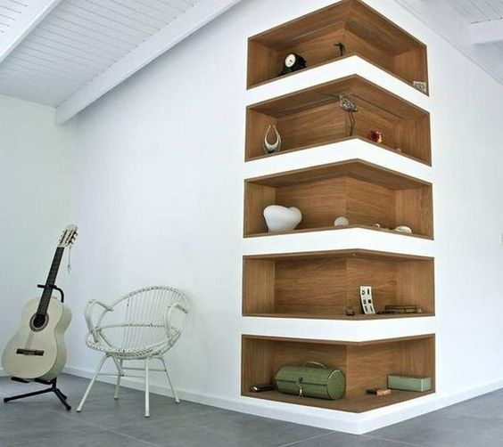 eye-catchy built-in outer corner shelves clad with plywood stand out and become part of decor