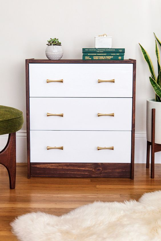 IKEA Rast hack with a stained look and contrasting white drawers plus elegant handles for a mid century modern feel