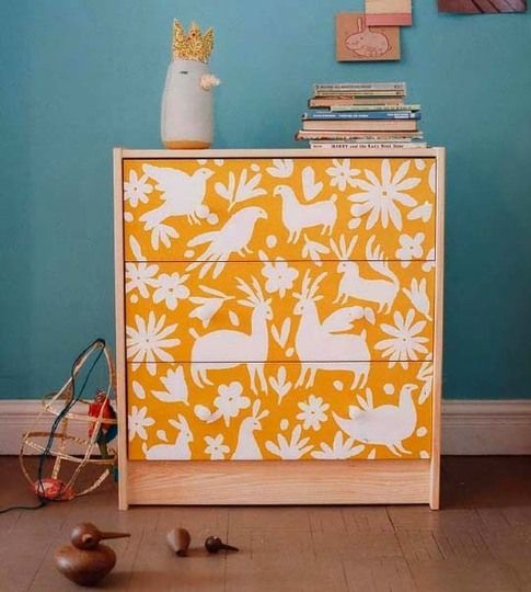 renovate IKEA Rast for a kids' space painting and stenciling it in some bold colors