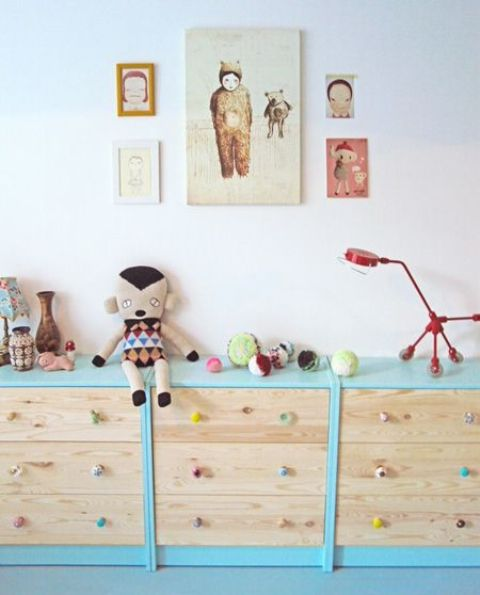 rock several IKEA Rast dressers for toy storage painting them in some bold colors and adding colorful knobs