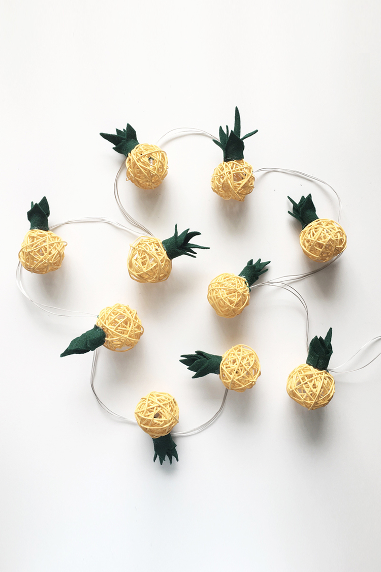 DIY pineapple string lights (via www.drawntodiy.com)