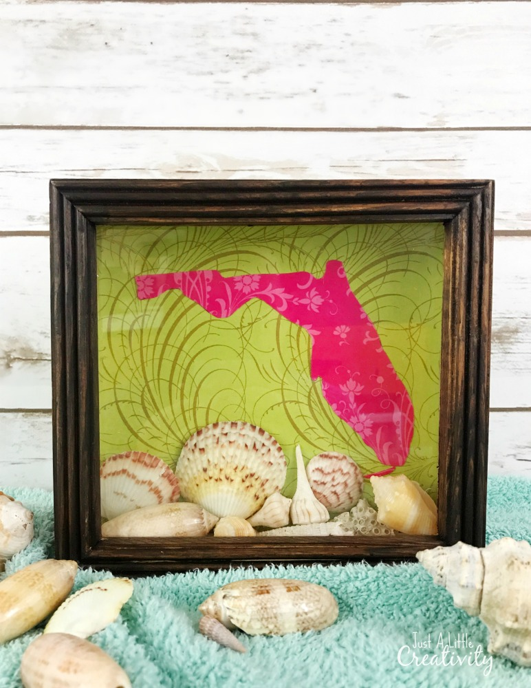 DIY colorful beach travel shadow box with shells (via www.justalittlecreativity.com)