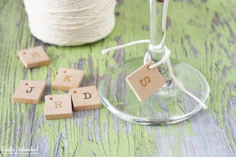DIY stamped wood tile glass charms (via blog.consumercrafts.com)