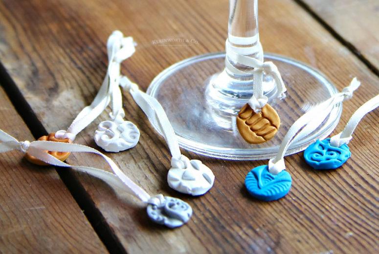 DIY stamped clay wine glass charms (via www.kleinworthco.com)