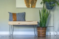 DIY wooden entryway bench with a rough wooden slab seat
