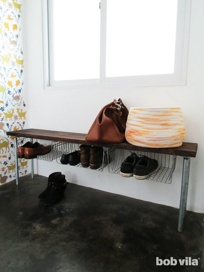 DIY wooden bench with metal baskets for shoe storage