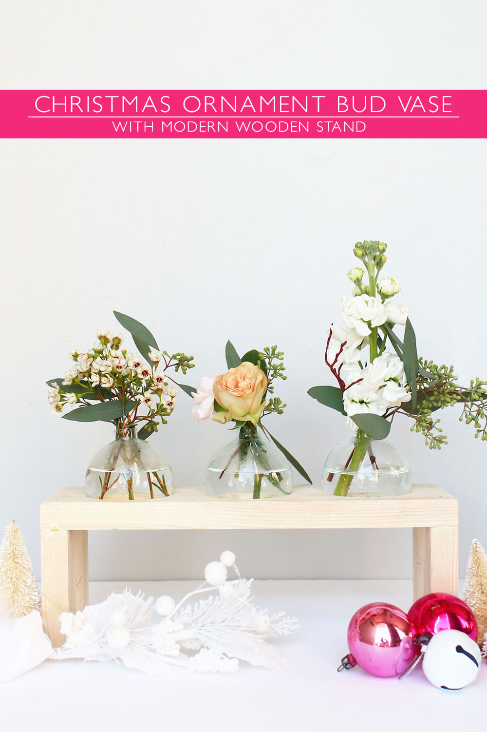 DIY bud vases of Christmas ornaments on a wooden stand