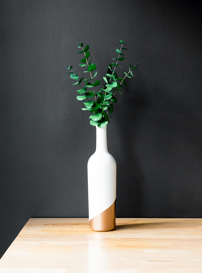 DIY 10 minute wine bottle white and copper vase (via www.bybrittanygoldwyn.com)