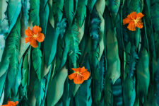 DIY tropical leaf and hibiscus flower backdrop