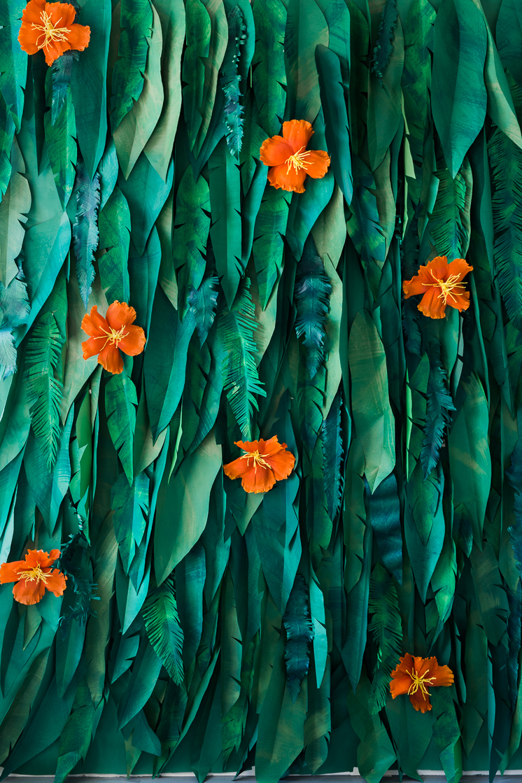 DIY tropical leaf and hibiscus flower backdrop (via thehousethatlarsbuilt.com)