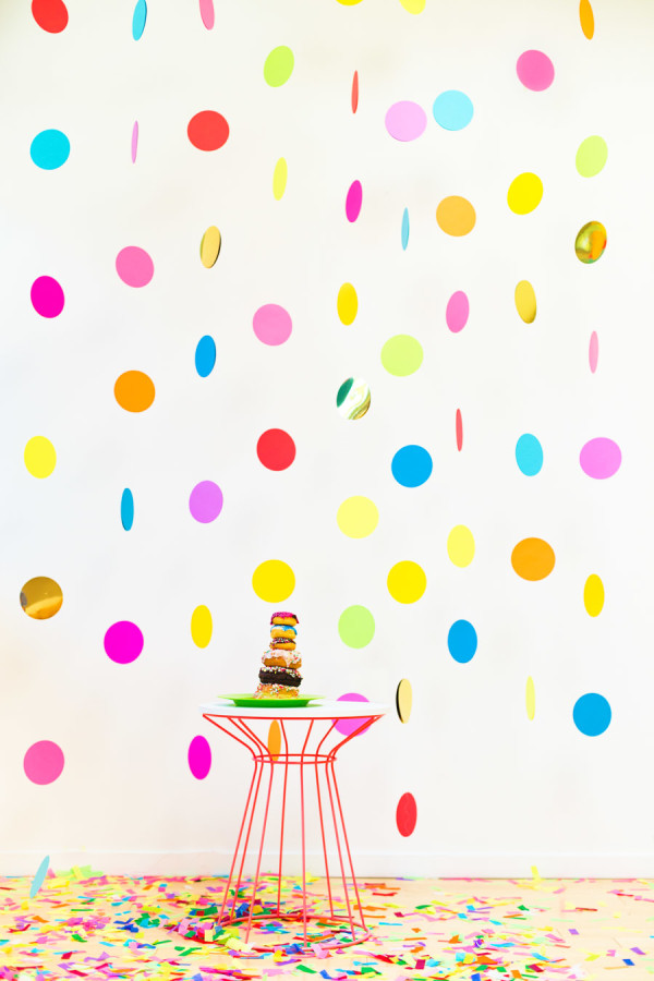 DIY floating colorful confetti backdrop (via studiodiy.com)