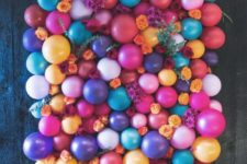 DIY colorful balloon backdrop with flowers and greenery