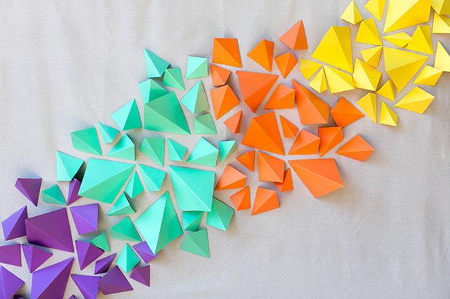 DIY 3D geometric origami-inspired backdrop (via greenweddingshoes.com)