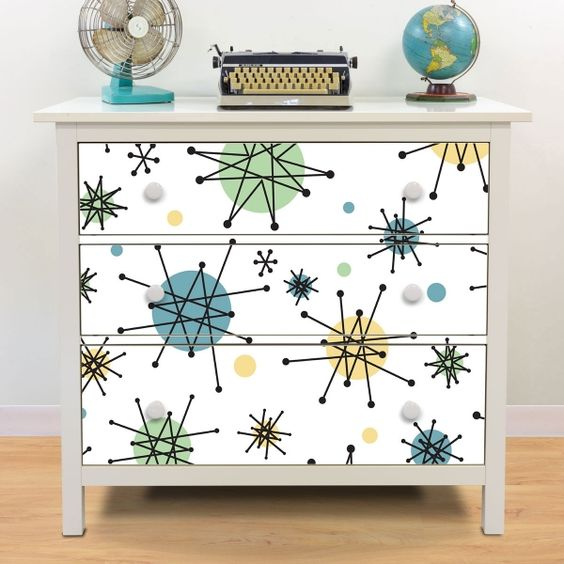spruce up a Hemnes dresser with 50s styled atomic starburst paper for a boy's room