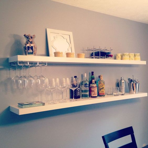 a simple floating home bar made of IKEA Lack shelves