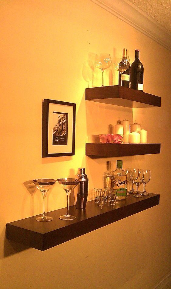 a small yet stylish floating home bar organized with dark IKEA Lack shelves