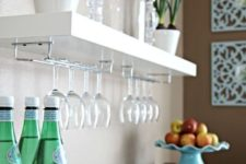 05 an IKEA Lack shelf with comfy glass holders is an ideal option for a home bar