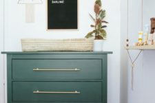 06 a Hemnes piece painted dark green with sleek brass handles for a cool smal changing table