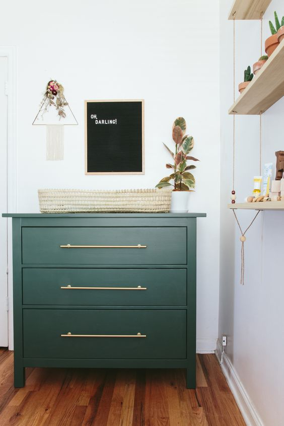 a Hemnes piece painted dark green with sleek brass handles for a cool smal changing table