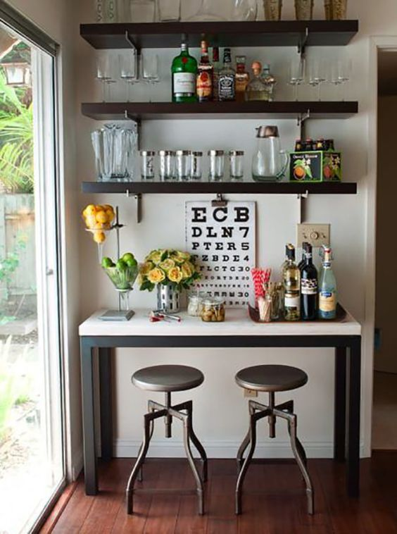 a chic IKEA Lack bar of shelves and a little console used as a bar countertop