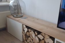 07 IKEA Besta console with a drawer, open storage and some firewood storage, which serves for decor
