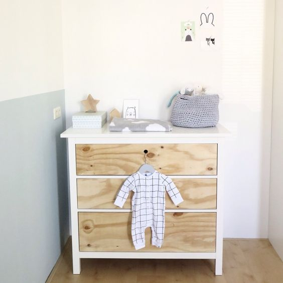 a renovated IKEA Hemnes dresser in white and light colored wood, no knobs or handles for a peaceful and natural nursery