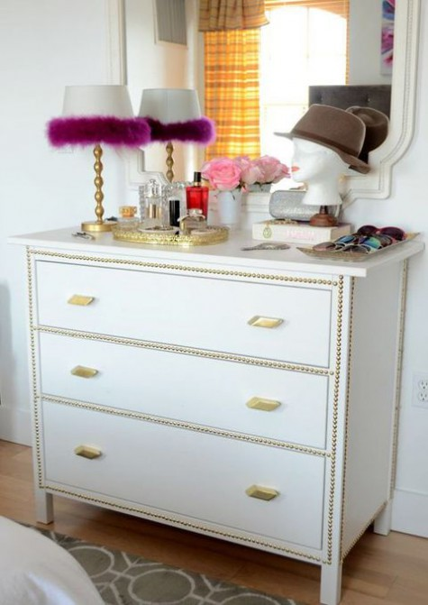 a white Hemnes piece spruced up with decorative nails and brass handles for a shiny glam look