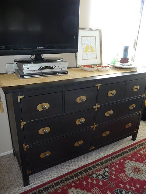 a black Hemnes dresser with brass corners, knobs and framing for a chic look