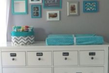 12 a Hemnes changing table with chalkboard stickers to mark each drawer