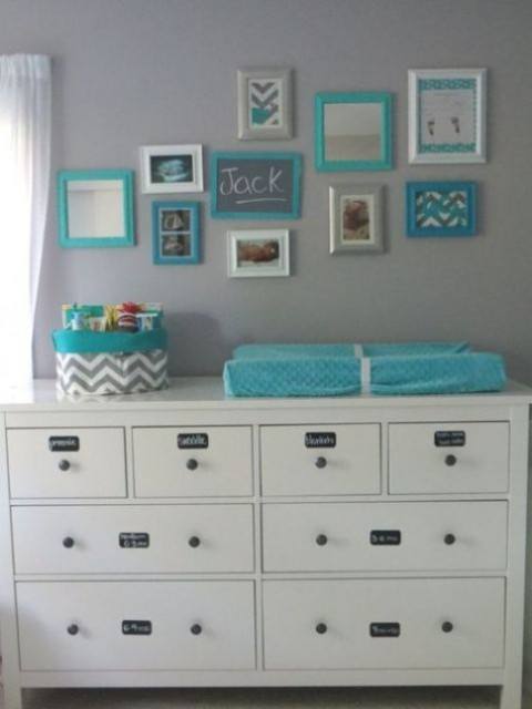 a Hemnes changing table with chalkboard stickers to mark each drawer