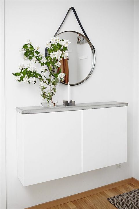 a small floating IKEA entryway console with a concrete countertop for a clean minimalist look