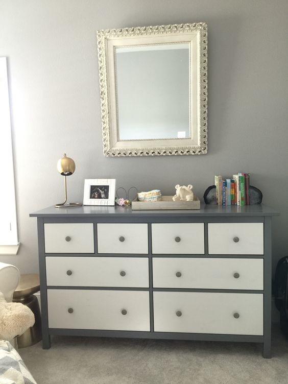 a Hemnes dresser painted graphite grey with white inlays and grey knobs for a cool look
