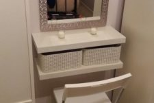 13 a small dressing table with IKEA Lack shelves and white woven basket drawers