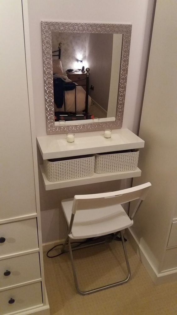 a small dressing table with IKEA Lack shelves and white woven basket drawers