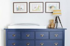 14 a Hemnes dresser painted midnight blue with vintage-inspired handles became a changing table