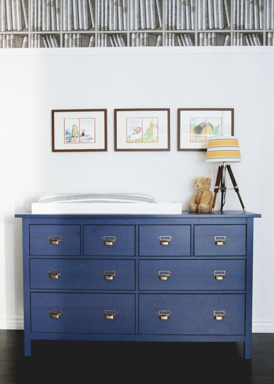 a Hemnes dresser painted midnight blue with vintage-inspired handles became a changing table